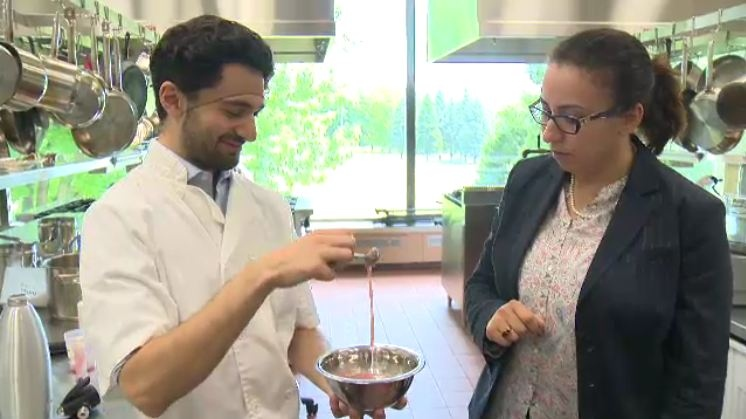 Jonathan Khouzam (left) of McGill mixes a batch of Frisson, a type of ice cream his team created that can be stored at room temperature. (CTV Montreal)