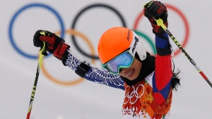 Vanessa Mae celebrates at the Sochi 2014 Winter Olympics in Krasnaya Polyana, Russia, on Tuesday, Feb. 18, 2014. (Christophe Ena)