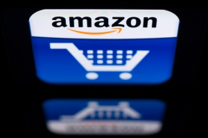 Amazon is launching a venue for storing, sharing and amassing feedback on documents, spreadsheets, presentations, Web pages, and other digital tools. (AFP PHOTO / LIONEL BONAVENTURE)