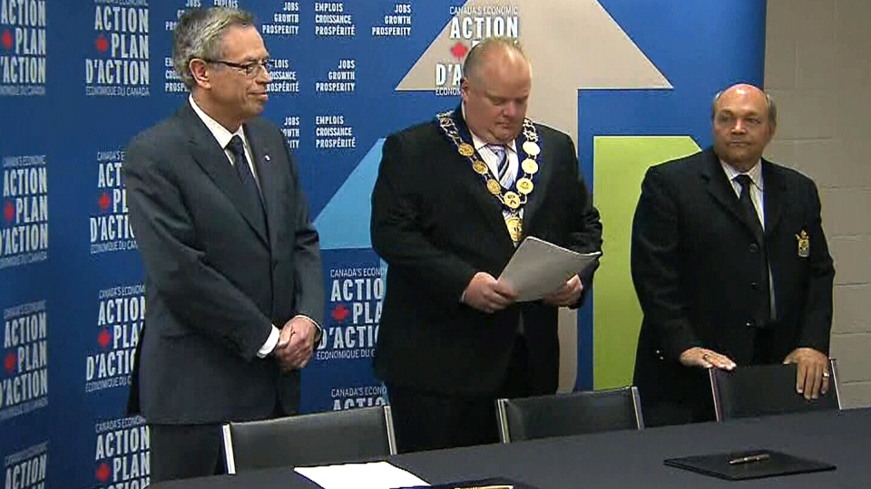 Finance Minister Joe Oliver, Toronto Mayor Rob Ford and Ontario Association of Municipalities President Russ Powers appear at a news conference in Toronto on Friday, July 11, 2014.