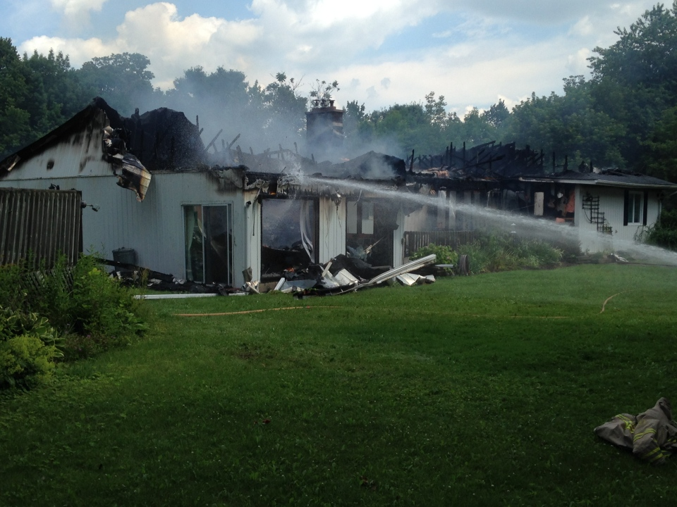 Fire crews put out a fire at home on Train Street south of Alliston on Saturday July 12, 2014. (Chris Garry / CTV Barrie)