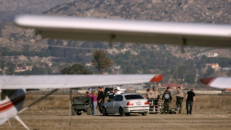 In a Tuesday, Dec. 27, 2011 photo, officers outside a field at Perris Valley Skydiving center after a skydiver was killed in Perris, Calif. (AP / The Press-Enterprise, Stan Lim)