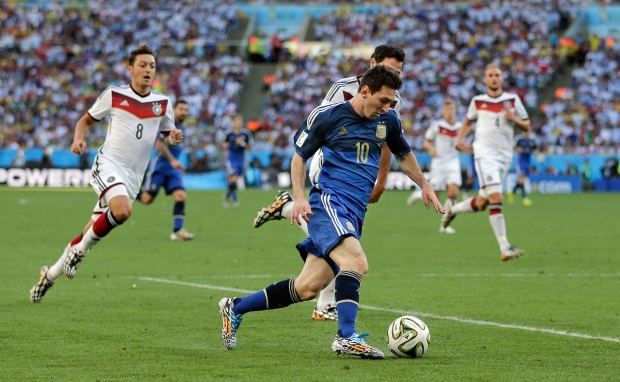 Argentina's Lionel Messi (10) runs with the ball during the World Cup final soccer match between Germany and Argentina at the Maracana Stadium in Rio de Janeiro, Brazil, Sunday, July 13, 2014. (AP / Matthias Schrader)