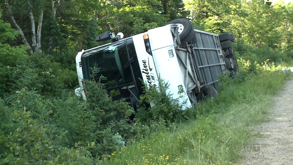 A bus is shown lying on its side after a crash on the Cabot Trail in Cape Breton, N.S., Sunday, July 13, 2014.