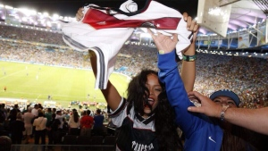 Rihanna celebrates at the World Cup finals  in Rio de Janeiro, Brazil, Sunday, July 13, 2014. (Rihanna / Twitter)