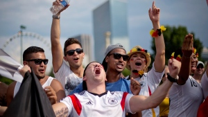 Lucke Ehret, centre, of Mannheim, Germany, celebrates at a viewing party in Centennial Olympic Park, Sunday, July 13, 2014, in Atlanta. (David Goldman)