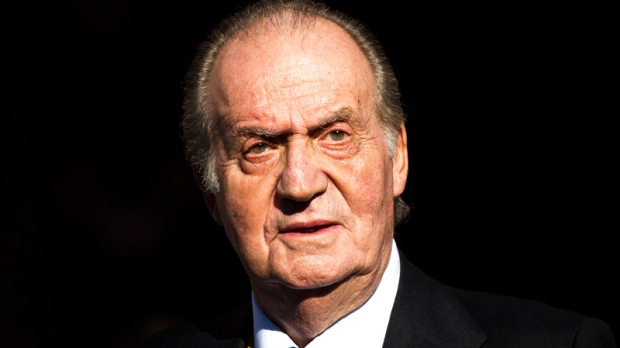 Spain's King Juan Carlos leaves after the official opening of the Parliament, in Madrid, Tuesday, Dec. 27, 2011. (AP / Daniel Ochoa de Olza)