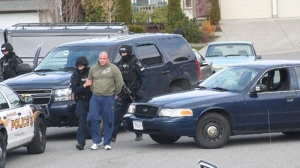 Heavily armed police arrest Jamie Bacon outside his Abbotsford, B.C. in this April 2009 file photo. (CTV)
