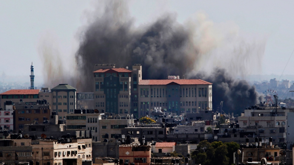 Smoke rises after an Israeli missile strike in Gaza City, Tuesday, July 15, 2014. (AP / Adel Hana)