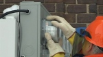 A smart meter is installed at a home in this file photo.