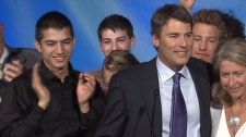 Vancouver Mayor Gregor Robertson celebrates his re-election with foster son Jinagh Navas-Rivas, far left. Nov. 19, 2011. (CTV)