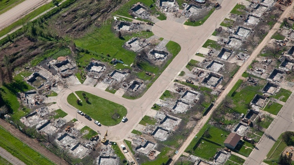 Burned-out homes from May's wildfire are shown in an aerial view of Slave Lake, Alta., prior to the arrival of the Duke and Duchess of Cambridge, July 6, 2011. (Jonathan Hayward / THE CANADIAN PRESS/)
