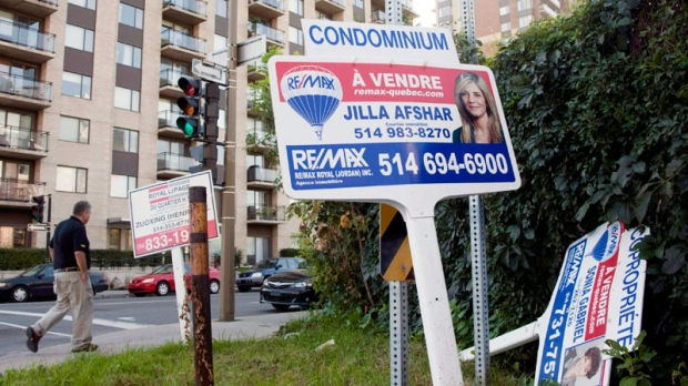 For sale signs stand in front of a condominium in Montreal on Sept. 27, 2011. (Ryan Remiorz / THE CANADIAN PRESS)