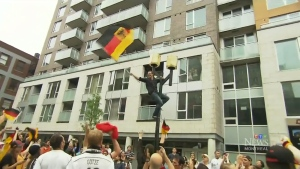 Adam Guzzo was given a $500 fine when he climbed a pole to celebrate Germany's World Cup victory.