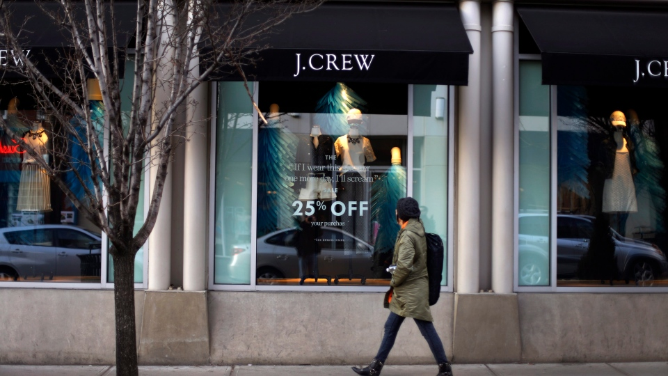In this March 24, 2014 photo, a pedestrian passes a J.Crew store in the Shadyside shopping district of Pittsburgh. (AP / Gene J. Puskar)