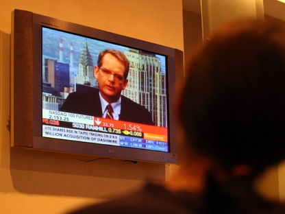 A man watches television in this file photo. (AP Photo/Lai Seng Sin)