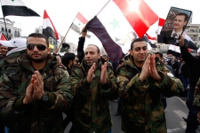Syrian soldiers chant slogans during a pro-regime rally in Damascus, Syria, Friday, Dec. 30, 2011. (AP / Muzaffar Salman)