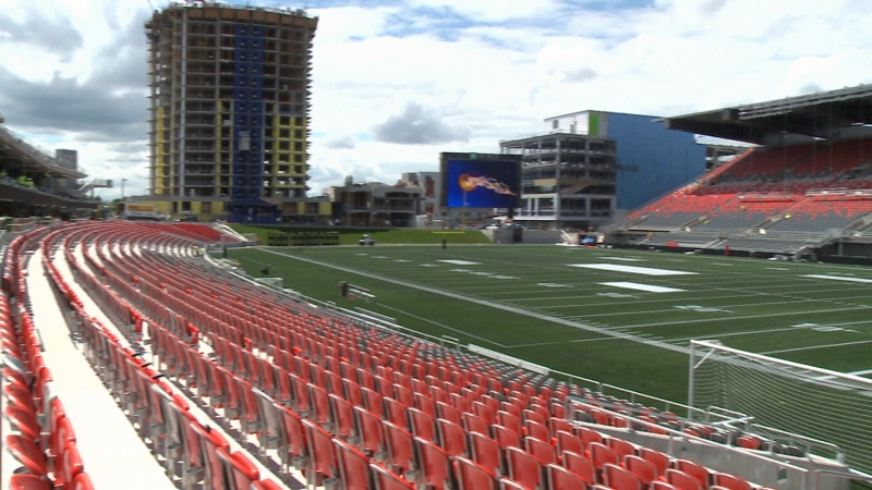 Hundreds of workers will spend the final hours primping and polishing the stadium in time for the Ottawa REDBLACKS home opener on Friday, July 18, 2014.