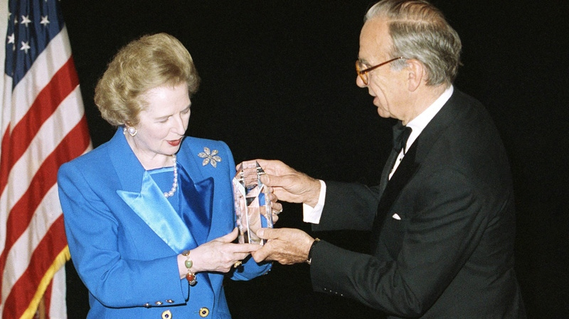 In this Nov. 14, 1991, file photo, Margaret Thatcher accepts the United Cerebral Palsy of New York's 37th Annual Humanitarian Award in New York from Rupert Murdoch. Murdoch is a political kingmaker in England and his native Australia.