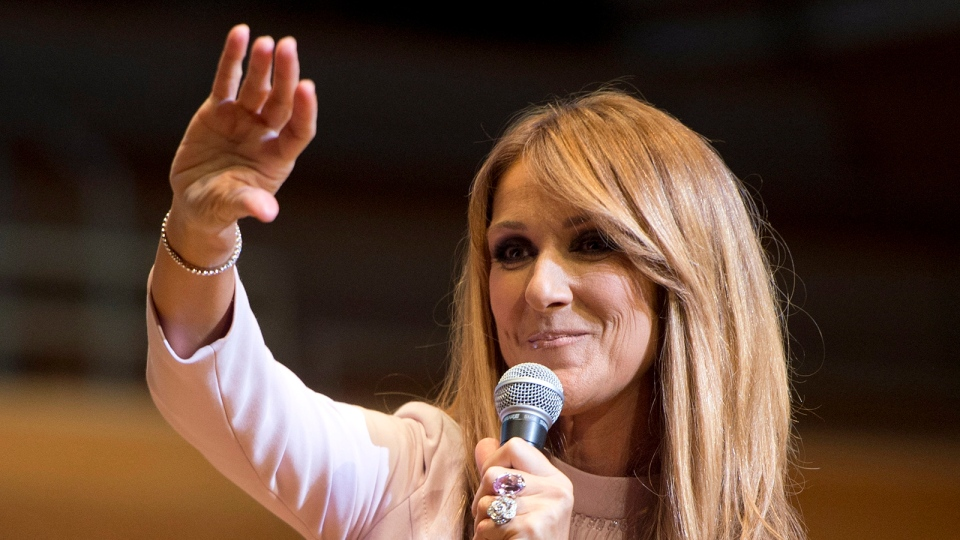 Celine Dion waves to fans at a charity event Wednesday, July 16, 2014 in Montreal. (Ryan Remiorz / THE CANADIAN PRESS)