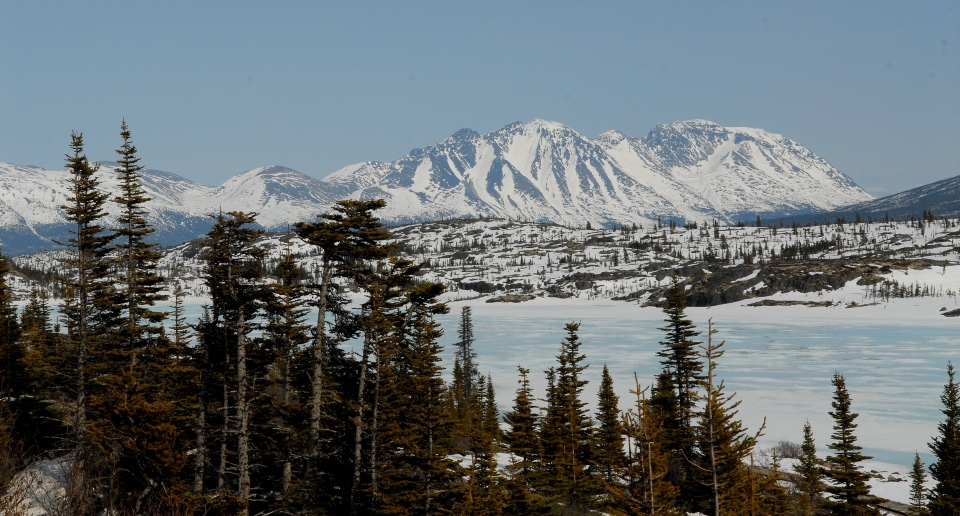 Snow covered mountains and a frozen lake along the Klondike Highway between Skagway, Alaska, USA and Whitehorse, Yukon Territory, Canada. (The Canadian Press / Don Denton)