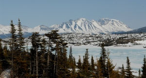 Snow covered mountains and a frozen lake along the Klondike Highway between Skagway, Alaska and Whitehorse, Yukon. (The Canadian Press / Don Denton)