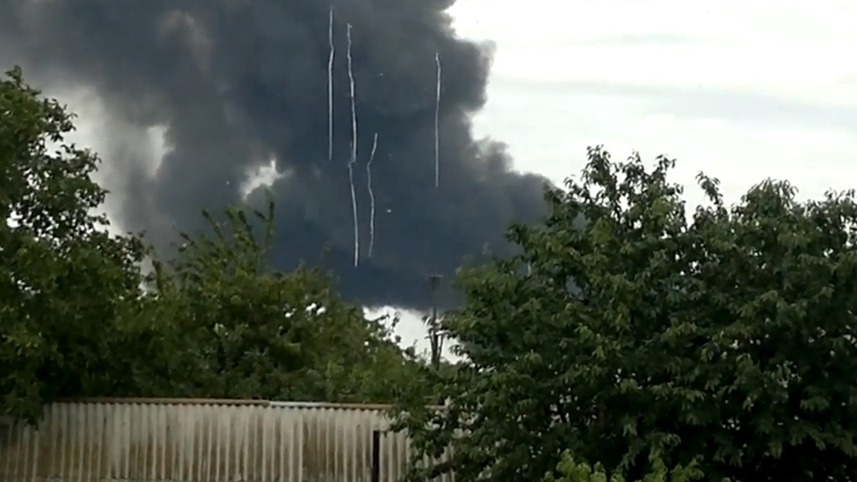 Debris falls from the sky as smoke billows from the wreckage from Malaysian Airlines plane that went down over Ukraine, as seen in this verified YouTube video from the scene.