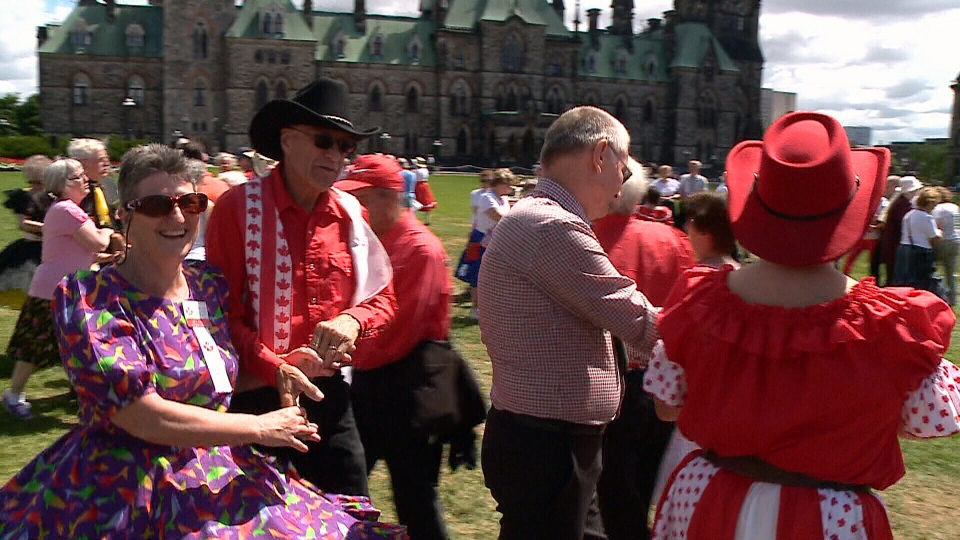 Square dancers display their colourful costumes on Parliament Hill, Wednesday, July 17, 2014