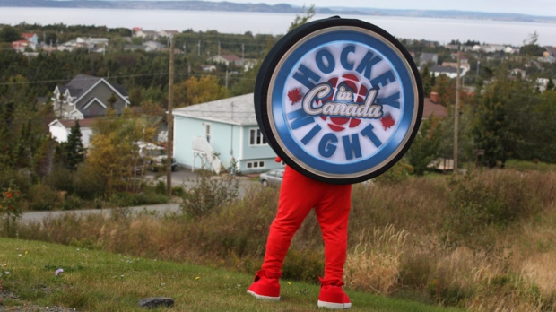 "In this undated file photo, the ""Puck"" poses at the Robert French Memorial Stadium in Conception Bay South, N.L., for the Kraft Hockeyville 2011 competition."