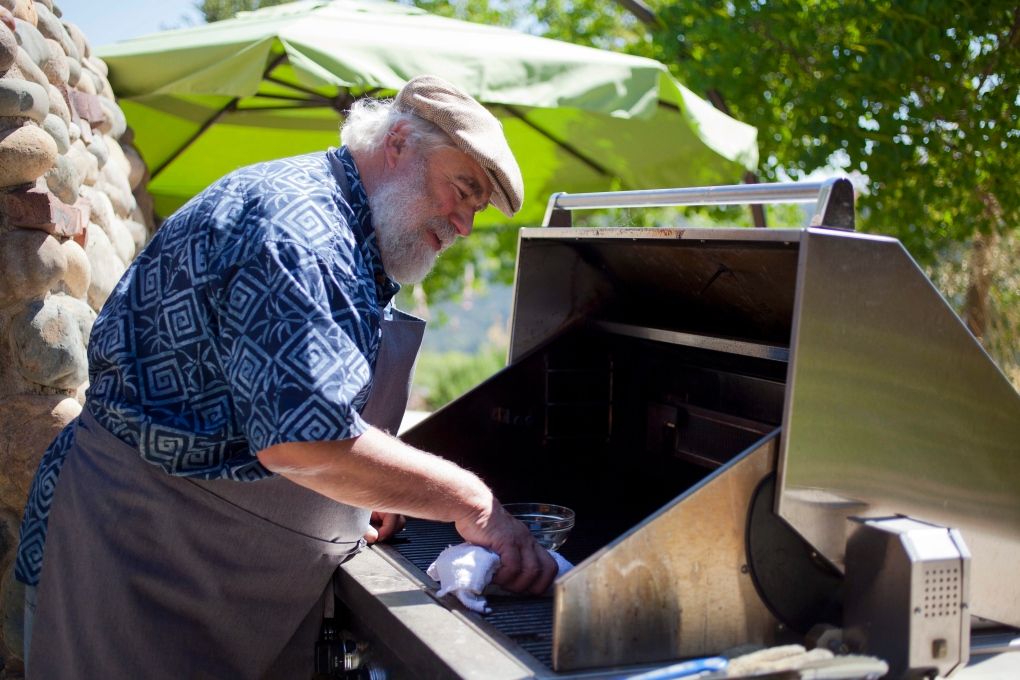California man prepares and cleans his barbecue