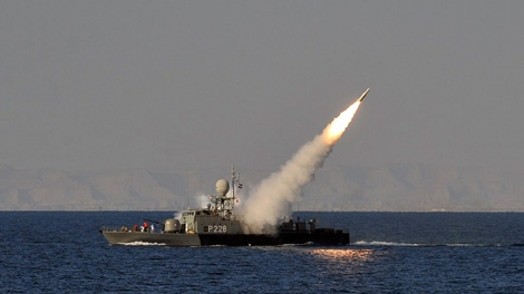 In this image made available by the Iranian Students News Agency, an Iranian navy vessel launches a missile during a drill at the sea of Oman, on Sunday, Jan. 1, 2012. (Amir Kholousi / ISNA)