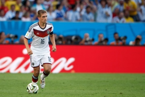 Philipp Lahm of Germany playing in the 2014 FIFA World Cup final. Lahm has announced he is retiring from the German team. (Ben Queenborough/BPI/REX)