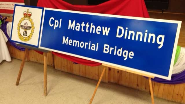 A sign for a newly dedicated bridge along Highway 21 (Bluewater Veteran's Highway) is seen in Wingham, Ont. on Friday, July 18, 2014. (Scott Miller / CTV London)