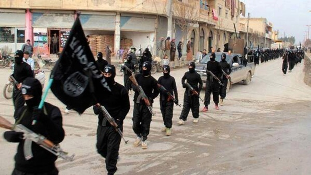 This undated image posted on a militant website on Jan. 14, 2014, shows fighters from the al Qaeda linked Islamic State marching in Raqqa, Syria. (AP / Militant Website)
