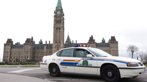 An RCMP vehicle sits guarding Parliament Hill in Ottawa, Wednesday, April 7, 2010. (Adrian Wyld / THE CANADIAN PRESS)