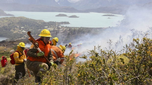 Firefighters work in an area of the Torres del Paine national park in Torres del Paine, Chile, Sunday Jan. 1, 2012.