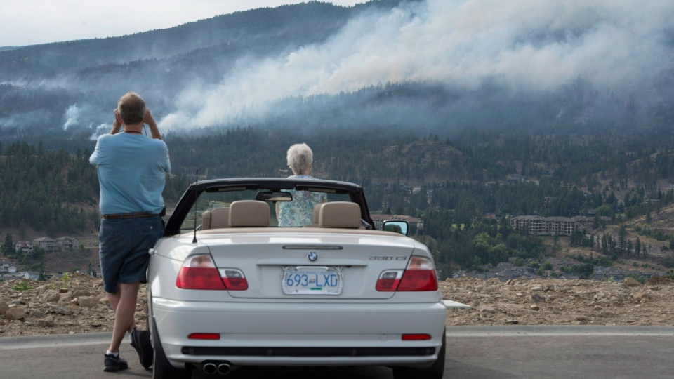 Evacuees watch smoke rise from the fires in B.C.