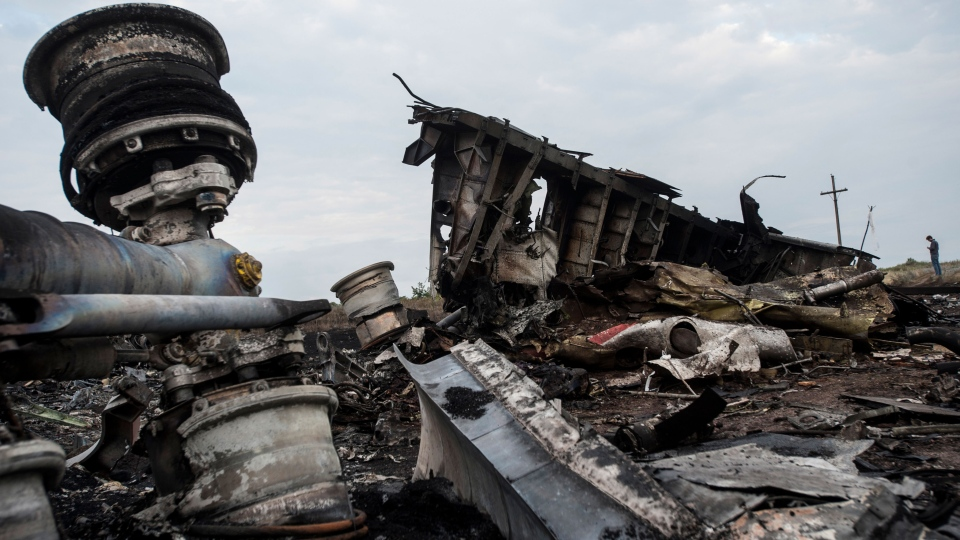 The wreckage of Malaysia Airlines Flight 17 near the village of Hrabove, eastern Ukraine, early Saturday, July 19, 2014. (AP / Evgeniy Maloletka)