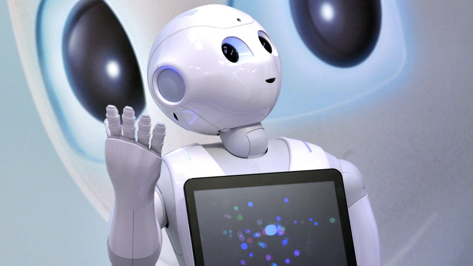 Japanese mobile communication giant Softbank's humanoid robot 'Pepper.' (AFP PHOTO / Yoshikazu TSUNO)