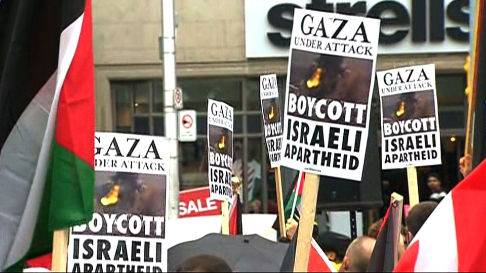 Demonstrators in Toronto protest against Israeli military action in Gaza Saturday, July 19, 2014.