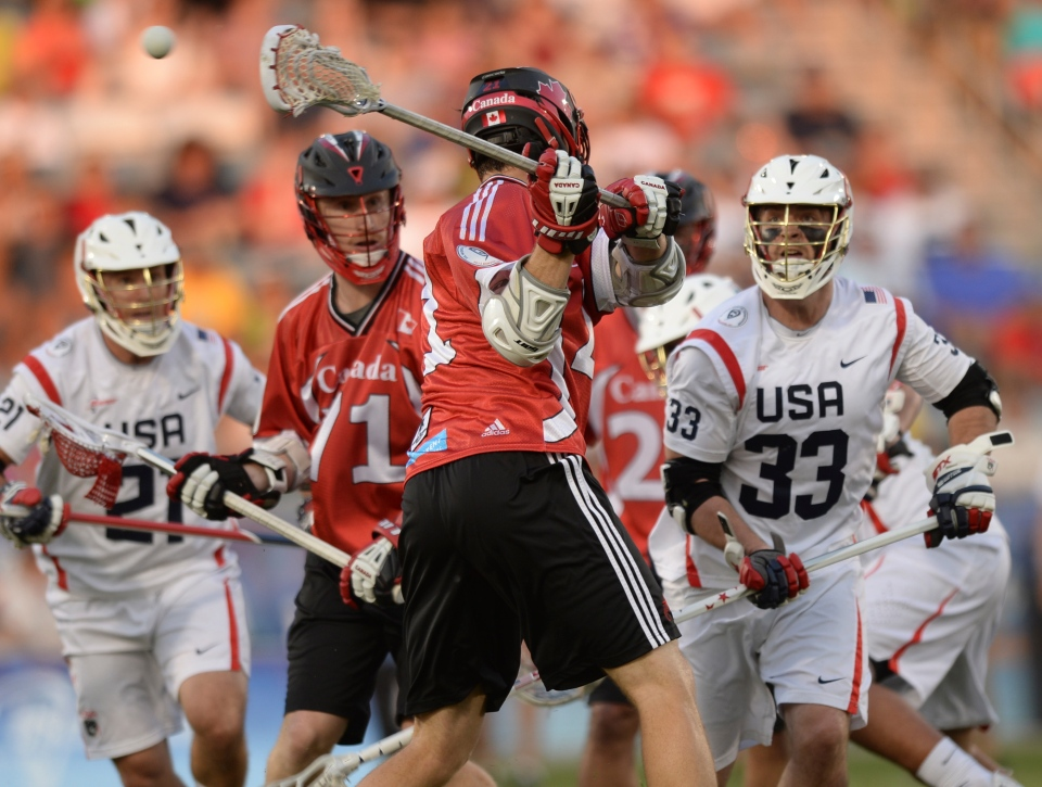 Canada midfielder Kevin Crowley (21) scores in the first half with a shot that he made behind his back against the United States an an FIL World Lacrosse Championship game Saturday, July 19, 2014, in Commerce City, Colo. (Karl Gehring/AP Photo, The Denver Post)