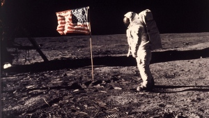 In this July 20, 1969 file photo provided by NASA shows astronaut Edwin E. 'Buzz' Aldrin Jr. posing for a photograph beside the U.S. flag deployed on the moon during the Apollo 11 mission. Aldrin and fellow astronaut Neil Armstrong were the first men to walk on the lunar surface. (AP / NASA, Neil Armstrong)