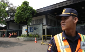 A security guard stands at the entrance of Jakarta International School (JIS) compound in Indonesia on May 8, 2014. (AP / Achmad Ibrahim)