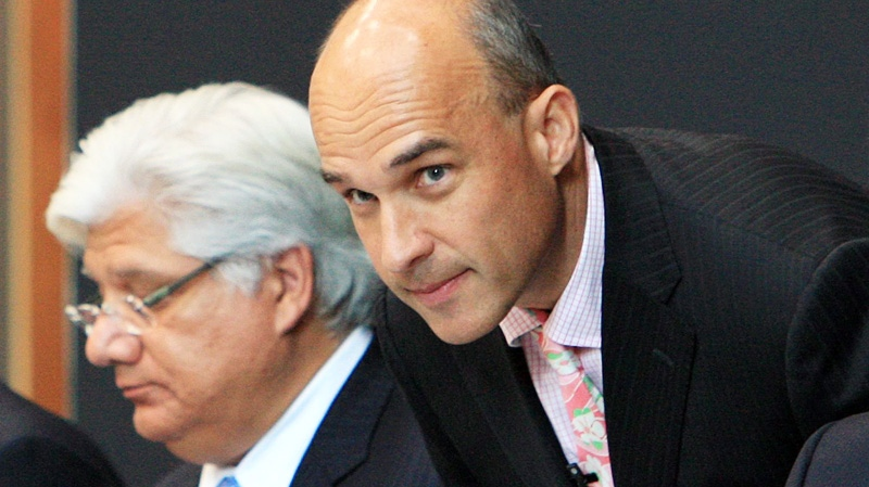 Co-chief executive Mike Lazaridis, left, and co-chief executive Jim Balsillie at the Research in Motion annual meeting in Waterloo, Ont., Tuesday, July 12, 2011. (Dave Chidley / THE CANADIAN PRESS)