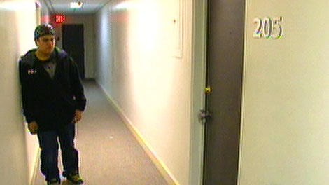 Building Manager Luis Alvarado stands near the door of the unit where he found the body of a woman on New Year's Eve. Tuesday, January 3.