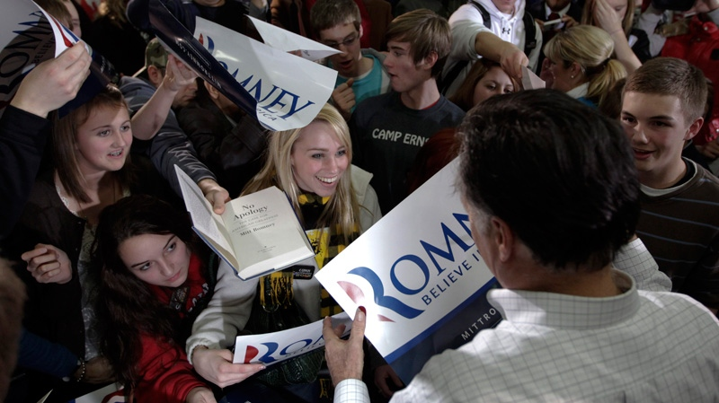 Republican presidential candidate, former Massachusetts Gov. Mitt Romney greets supporters after a campaign stop in Clive, Iowa, Monday, Jan. 2, 2012. (AP / Chris Carlson)