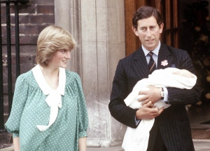 Prince Charles and wife Princess Diana take home their newborn son Prince William, as they leave St. Mary's Hospital in London on June 22, 1982.  (AP / John Redman)