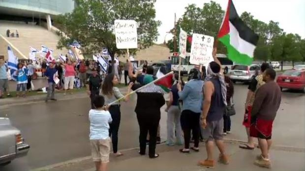 Pro-Israel and pro-Palestine protesters at the Canadian Museum for Human Rights.