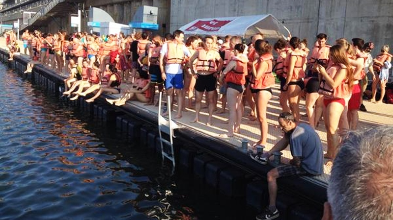 Swimmers are seen lining up for the early morning