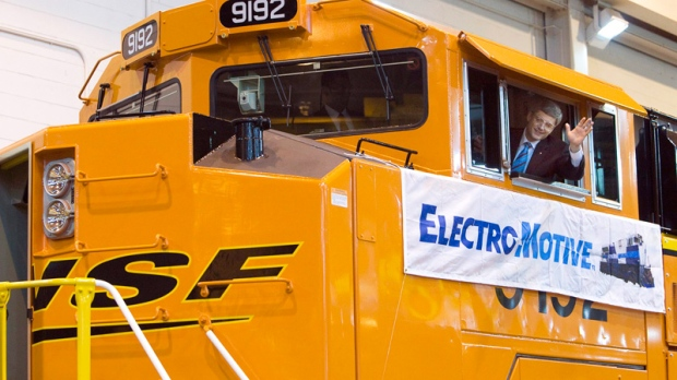 Prime Minister Stephen Harper waves from the cabin of an engine at Electro-Motive Diesel in London, Ont. on Wednesday, March 19, 2008. (Frank Gunn / THE CANADIAN PRESS)